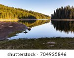 mountain lake with pine forest... | Shutterstock . vector #704935846
