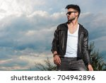 young sexy man in leather... | Shutterstock . vector #704942896