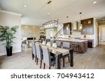 open plan kitchen equipped with ... | Shutterstock . vector #704943412