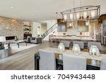 open plan kitchen equipped with ... | Shutterstock . vector #704943448