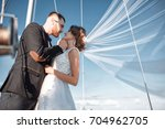 wedding couple is hugging on a... | Shutterstock . vector #704962705