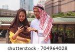 aarab businessman and... | Shutterstock . vector #704964028