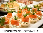 tartlets with cheese filling... | Shutterstock . vector #704969815