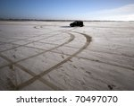 Winter Car Tracks On Snowy Beach