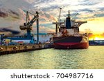 ship under loading in port of... | Shutterstock . vector #704987716