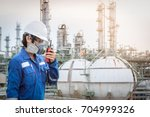 technician with gas mask... | Shutterstock . vector #704999326