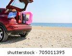 car on beach  | Shutterstock . vector #705011395