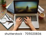 a person works at a computer... | Shutterstock . vector #705020836