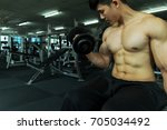 fitness man in training showing ... | Shutterstock . vector #705034492