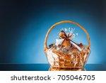 gift basket on blue background | Shutterstock . vector #705046705