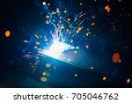 artistic welding sparks light ... | Shutterstock . vector #705046762