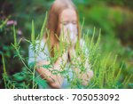young woman sneezes because of... | Shutterstock . vector #705053092