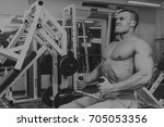 a man is exercising in the gym | Shutterstock . vector #705053356