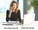 shot of a financial consultant... | Shutterstock . vector #705101536