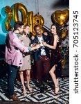 group of friends celebrating... | Shutterstock . vector #705123745