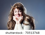 young beautiful girl rejoices... | Shutterstock . vector #70513768