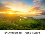 Dramatic vivid sunrise and fog with romantic cloudy sky and mountain background. Beauty of dawn sunbeam valley scene at Khao Takhian Ngo, Petchabun, Thailand.