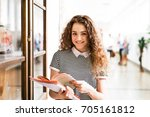 teenage girl with notebooks in... | Shutterstock . vector #705161812