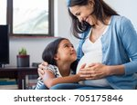 lovely daughter touching mother'... | Shutterstock . vector #705175846