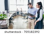 young businessman and... | Shutterstock . vector #705182392