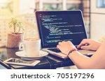 a female programmer typing... | Shutterstock . vector #705197296