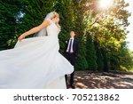 bride spinning in front of her...   Shutterstock . vector #705213862