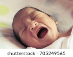 close up new born baby crying ...   Shutterstock . vector #705249565