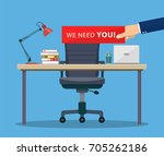 Stock vector office workplace and business chair with hand holding cardboard paper with we need you message 705262186