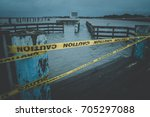 flooded boat dock in clear lake ... | Shutterstock . vector #705297088