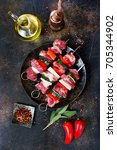 raw kebab with vegetables | Shutterstock . vector #705344902