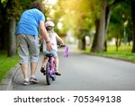 happy father teaching his... | Shutterstock . vector #705349138