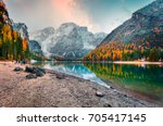 Popular photographers attraction of Braies Lake. Colorful autumn landscape in Italian Alps, Naturpark Fanes-Sennes-Prags, Dolomite, Italy, Europe. Beauty of nature concept background.