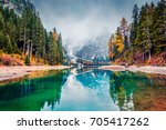 first snow on braies lake....   Shutterstock . vector #705417262