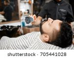 hairstylist combing out and...   Shutterstock . vector #705441028