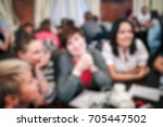 blurred people in the banquet... | Shutterstock . vector #705447502