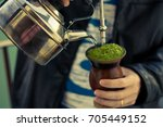 man serving chimarrao   the... | Shutterstock . vector #705449152