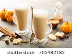 pumpkin spice latte in tall... | Shutterstock . vector #705482182