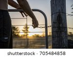shutting the farm gate at sunset | Shutterstock . vector #705484858