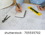 architect or planner working on ... | Shutterstock . vector #705535702
