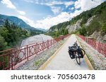 alpe adria cycle path  italy.... | Shutterstock . vector #705603478