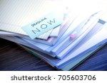 deadline now  the pile of... | Shutterstock . vector #705603706