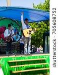 Small photo of Kremenchug, Ukraine - June 3, 2017: National Ukrainian musical group in ethnic costumes acts on Strawberry festival