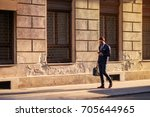 a handsome young businessman... | Shutterstock . vector #705644965