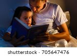 caring father is reading a book ... | Shutterstock . vector #705647476