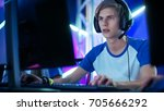 professional boy gamer plays in ... | Shutterstock . vector #705666292