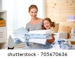 happy family mother housewife... | Shutterstock . vector #705670636