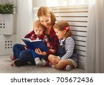 Mother Reads Book To Children...