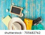 beach accessories on the blue...   Shutterstock . vector #705682762