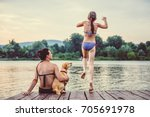mother and dog sitting on a... | Shutterstock . vector #705691978