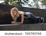 fit woman doing plank exercise... | Shutterstock . vector #705795745
